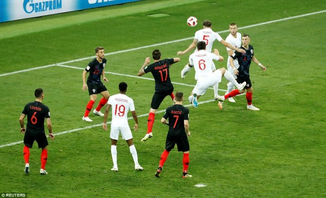 John Stones rises highest to direct a free header towards goal but sees his effort agonisingly cleared off the line by Croatia
