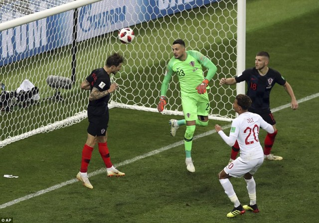Croatia right-back Sime Vrsaljko is back on the line to head Stones' effort away from goal and keep the semi-final level