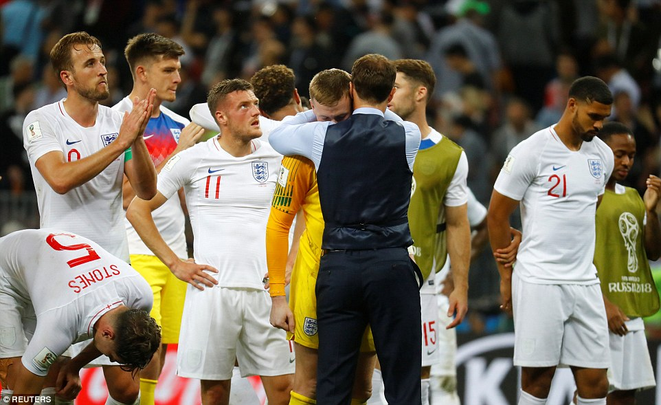 Southgate is pictured comforting his England players in Moscow after the Three Lions were beaten 2-1 by Croatia in the World Cup semi final