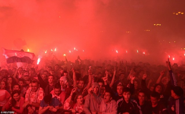 A sea of flare smoke obscures delighted fans in Zagreb as Croatia beat England to reach the final of the World Cup