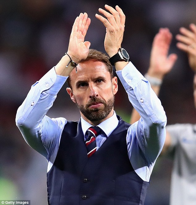 Gareth Southgate applauds the England fans after their extra-time defeat by Croatia