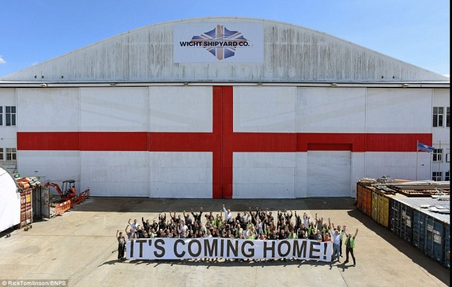 Boat builders in Cowes have painted the biggest cross of St George in Britain on their hangar doors