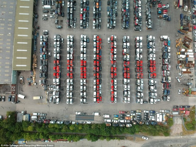 Workers at Hills Salvage and Recycling in Skelmersdale, Lancashire, which sits in the flight path for both Manchester and Liverpool John Lennon airports, created the huge flag from 176 red and white cars to cheer the team on