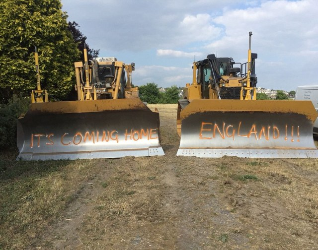 Ally Ginger, 29, and his workmates who are busy building the football pitches in Central Park Plymouth have spraypainted their bulldozers, with temporary paint, to get behind the boys. They predict a 2-0 win for the Three Lions