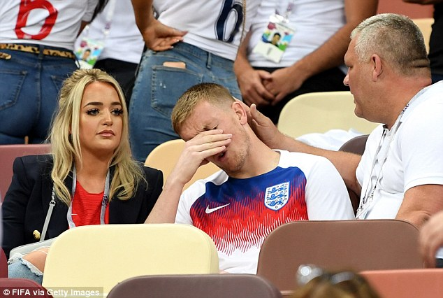 After he left the pitch and joined her in the stands, she consoled him as he hung his head in misery