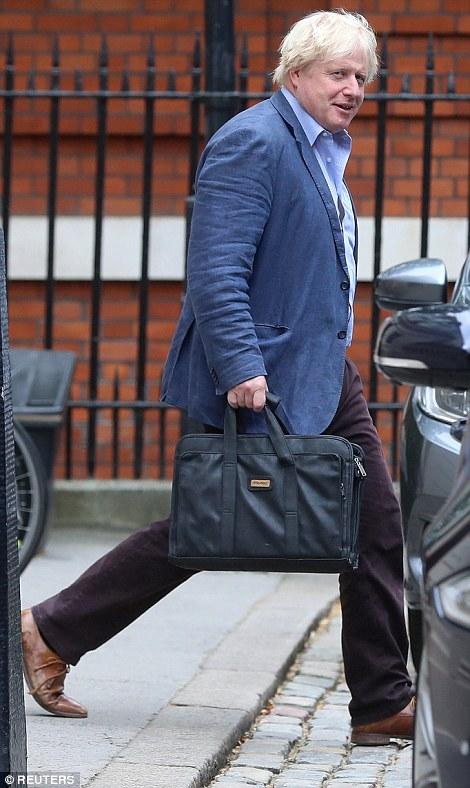 Boris Johnson picturedleaving his London residence today
