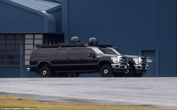 The presidents motorcade - including enormous 4x4 vehicles - is pictured on the tarmac at Prestwick