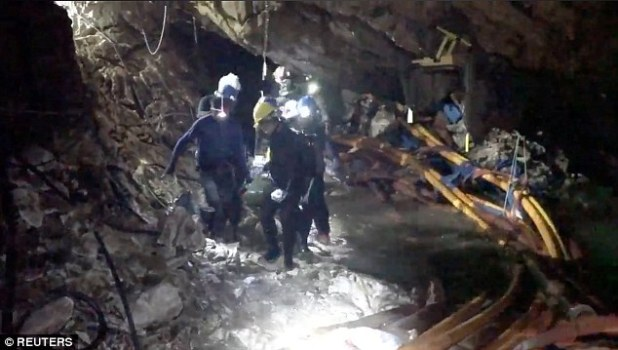 Another part of the video shows the team carrying one of the boys while the pipes used to pump out water are seen in the background
