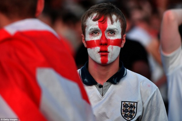 This England fan's tear-stained face sums up the pain of yet another World Cup defeat for the team last night