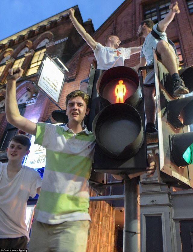 Intoxicated fans were seen scaling traffic lights and blocking traffic in Birmingham