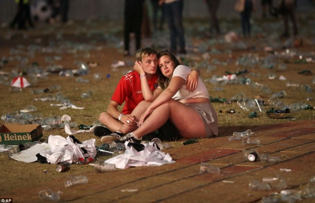 England fans cling to eachother in Hyde Park last night as the come to terms with yet another World Cup defeat