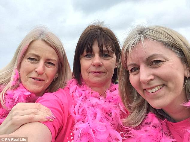 Ms Morawaka, pictured centre with friends, now wants to raise awareness about bladder cancer because she did not have the tell-tale sign of blood in her urine