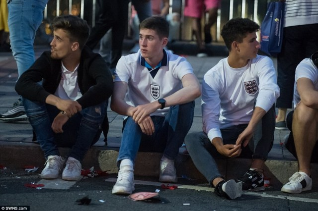 Youngsters in their England shirts sat beside the road looking utterly despondent in Birmingham city centre