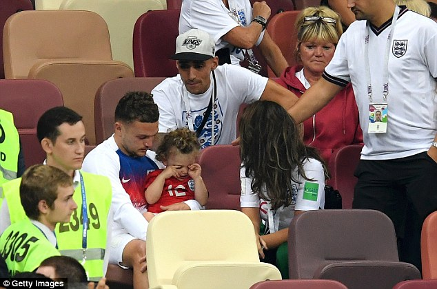 Kieran Trippier of England speaks with his family following England's defeat to Croatia in Moscow as the squad bids farewell to making the final