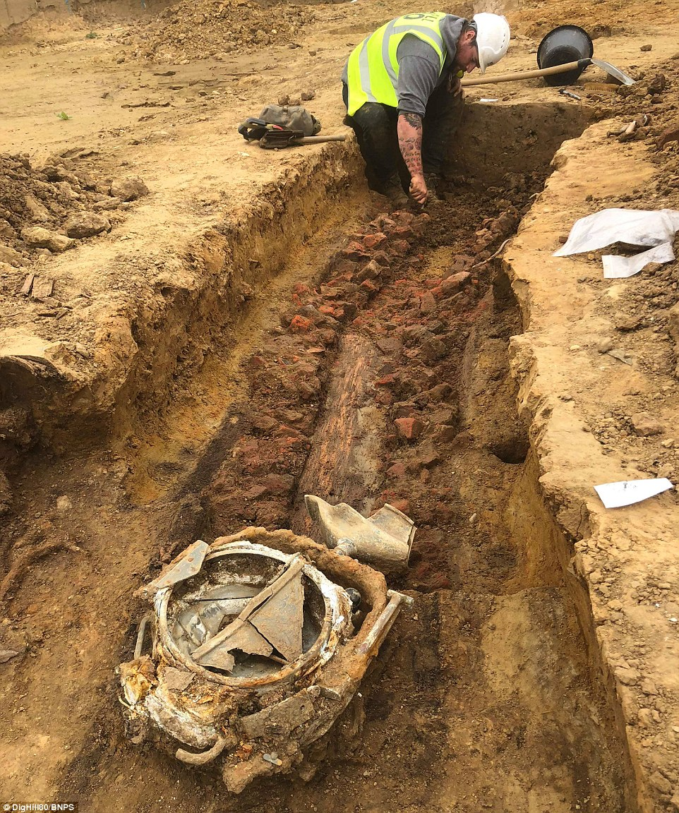 These include helmets, rifles, ammunition, search lights, water bottles, cooking utensils, coffee pots, watches, cap badges, toothbrushes and even a bottle of HP sauce and a tin of Andrews Liver Salts. This image shows workers in the trench where a German searchlight was discovered