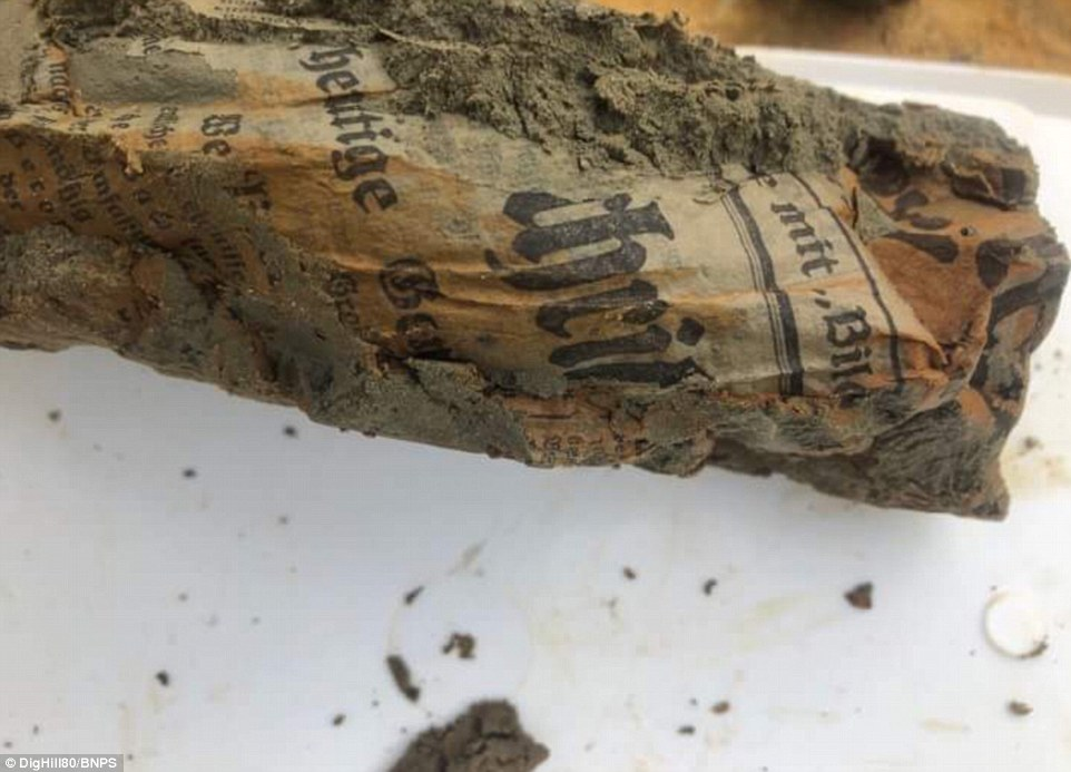 Experts believe that approximately 100 of the dead are German, most of them killed by shot or shell fire during the First Battle of Ypres in November 1914. This image shows a German newspaper which is around 100 years old