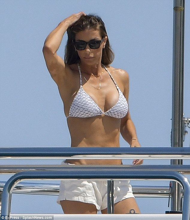 Keeping cool! Sweating in the baking French Riviera, Jennifer fussed over her brunette locks as she ran her fingers through her waves