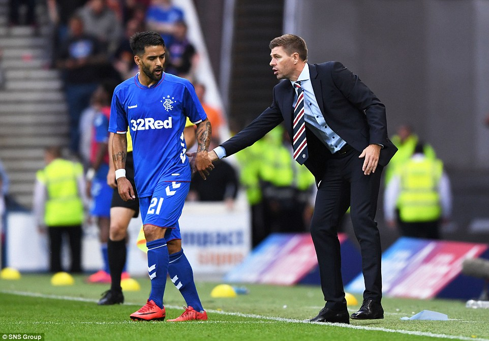 New manager Gerrard (right) has a word with Portuguese winger Daniel Candeias (left) on the touchline