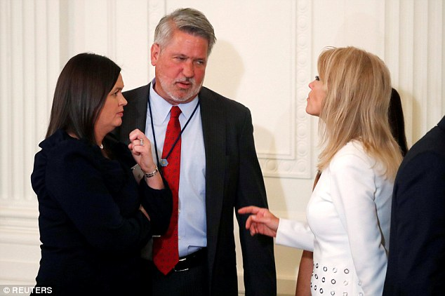 Bill Shine, newly hired as Deputy Chief of Staff for Communications, talks with White House Press Secretary Sarah Huckabee Sanders and counselor Kellyanne Conway after President Donald Trump announced Judge Brett Kavanaugh as his nominee for the U.S. Supreme Court