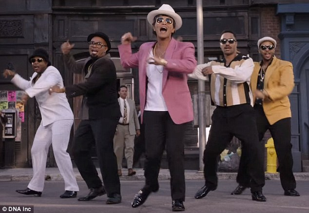 Where it began: Bruno Mars struts his stuff during the music video for Uptown Funk