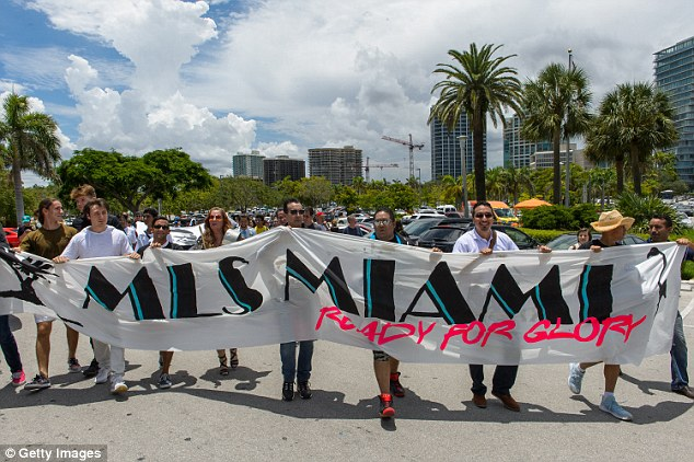 Fans showed their support for the plans as they held banners outside the Miami City Hall