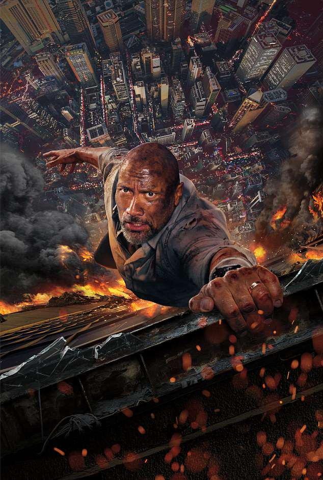 Dwayne Johnson hangs on to a ledge on a burning 240-storey tower in Skyscraper