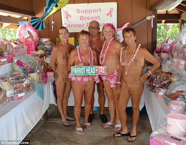 One group are seen raising money for breast cancer research at the resort, wearing only pink leis around their waists and beads