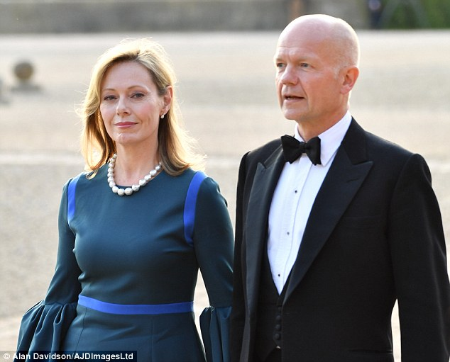 Guests are expected to enjoy a meal of Scottish salmon, English beef and a desert of strawberries and cream. Pictured: William Hague arrives