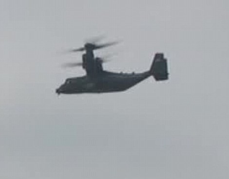 An Osprey helicopter carrying US Marines follows Mr Trump down to Sandhurst for his meeting with Theresa May