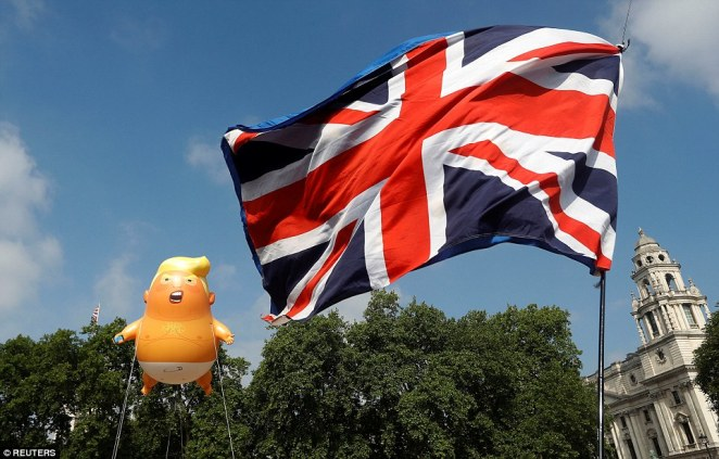 As the President woke up in the UK, the blimp soared in the skies above Parliament Square beside a Union Jack flag