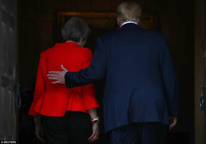 Mr Trump put his arm around the PM as they walked in for talks overshadowed by some of his criticisms of her