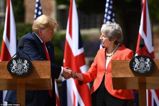 Theresa May said that 'no two countries do more' together to keep their people safe as she held a press conference with Donald Trump at Chequers today