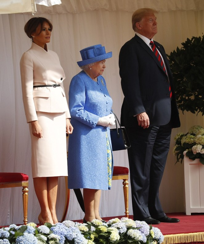 Elegant: Melania also made a quick style change on Friday afternoon, changing into a sophisticated Christian Dior suit, and pulling her hair into a classy chignon bun before meeting the Queen at Windsor Castle