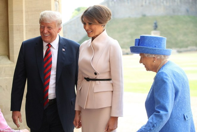 Queen Elizabeth II, President of the United States Donald Trump, and First Lady Melania Trump walk from the Quadrangle after inspecting the Guard at Windsor Castle