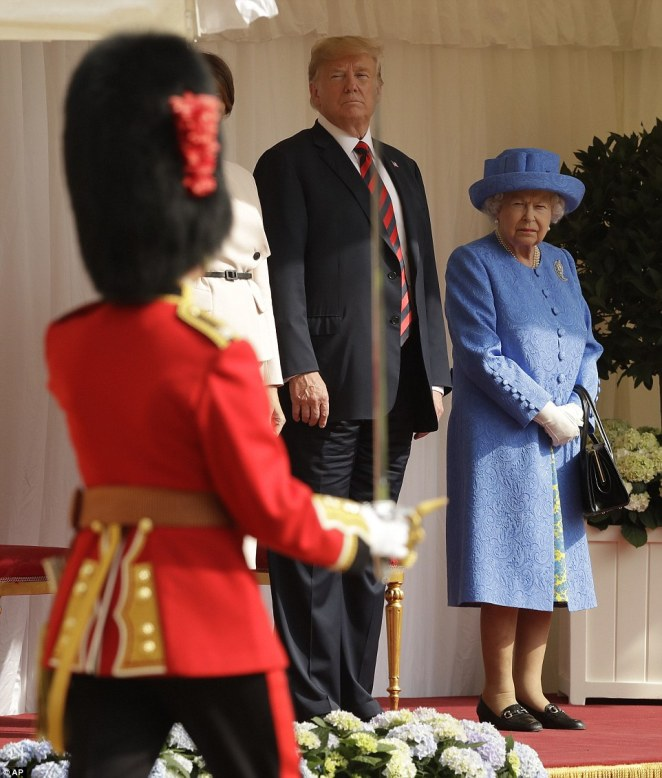 The Guard of Honour - formed by the Coldstream Guards - passed in front of Donald Trump and the First Lady as they stand beside the Queen