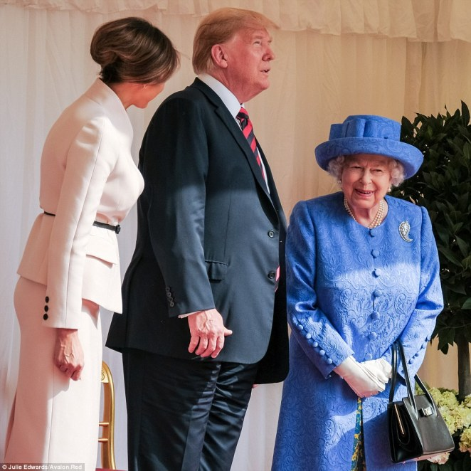 Something funny? At one point, the Queen cracked a wide smile while talking to Melania about something
