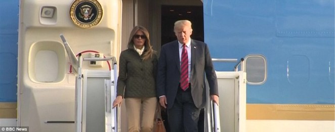 Donald Trump and Melania Trump descend the steps of Air Force One after touching down in Glasgow as part of his UK visit this weekend