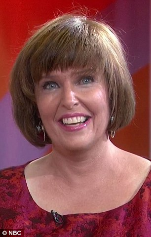 All smiles: Susan'slong curly hair was cut into a sleek bob with bangs, and it was dyed a warm brown