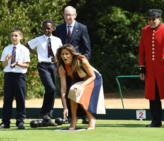 Fun and games: For her first activity of the day, Melania visited the Royal Hospital Chelsea, where she enjoyed a game of bowls with some local schoolchildren and the Chelsea Pensioners