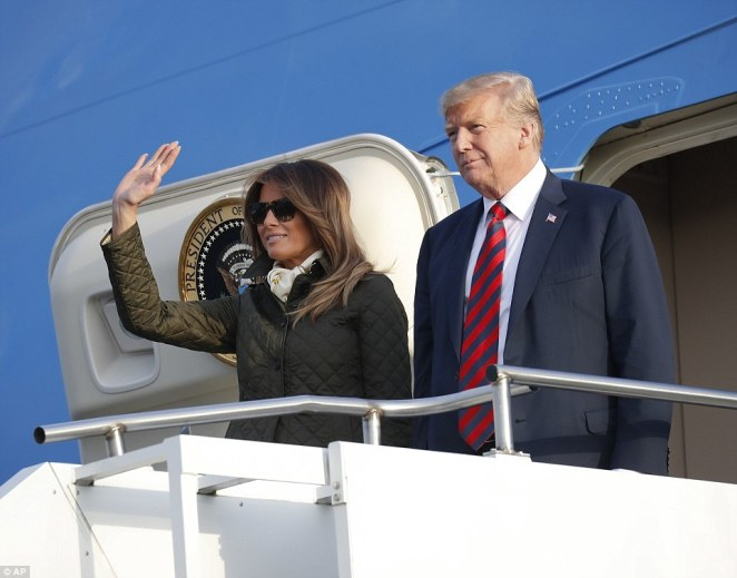 First Lady Melania Trump waves as she exits Air Force One beside President Donald Trump as they prepare to continue his visit to Britain