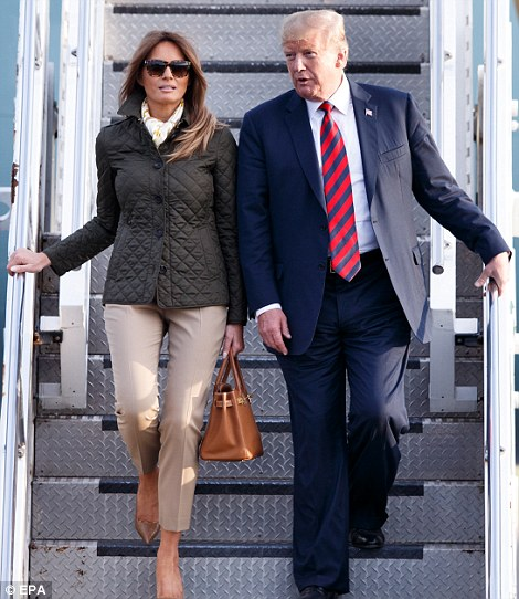 Greetings! Melania managed a small wave to the waiting photographers and crowds before she and Donald made their way down the steps and onto the tarmac atPrestwick Airport