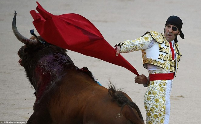 Spanish matador Juan Jose Padilla performs a pass to a Jandilla fighting bull during a bullfight of the Sanfermines festival in Pamplona, northern Spain on July 13