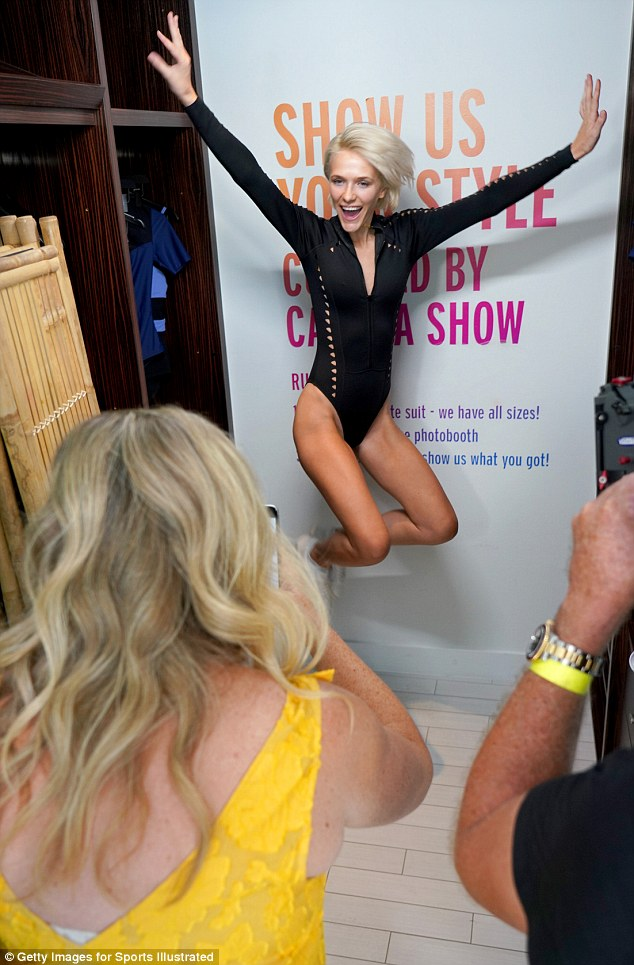 Standing out: One aspiring model jumped in the air while her photo was being taken