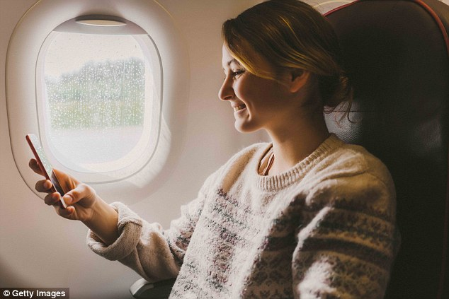 Whether you're heading to the Caribbean or Iceland, it's important to bring light, but warm layers with you on the airplane to counteract cool cabin temperatures (stock image)