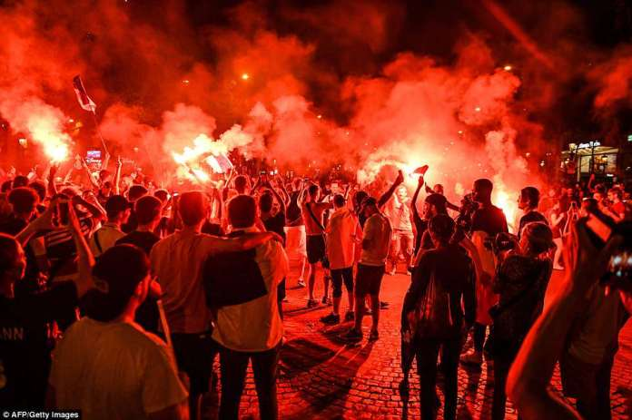Fans have poured into the streets across the country after the country's second World Cup win, many waving flags and letting off smoke bombs