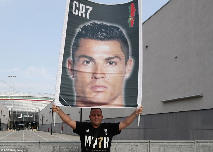 This Juventus supporter came with a Ronaldo placard as he posed for a photograph outside the Allianz Stadium in Turin