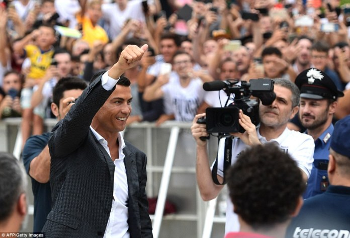 The Portuguese star was all smiles and gave fans the thumbs up as he completes his move to Italian champions Juventus