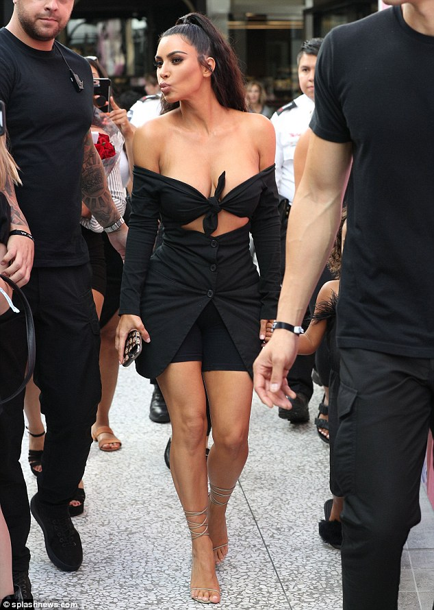 Putting her best foot forward:The reality TV superstar wore her tresses half up, half down as she teamed her very sexy top with cycling shorts, an open skirt and strappy heels