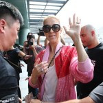 Celine Dion arrives Taiwan in flashy tracksuit