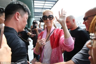 Radiant: She swept her hair into a tight ponytail and accessorised with dark shades, to draw attention to her youthful and glowing complexion as she greeted fans at the terminal